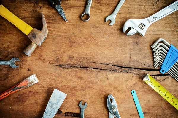 Set of work tools on old grunge wooden background with copy space