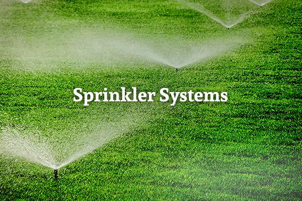 "A green lawn with sprinklers running and the words ""Sprinkler Systems"""