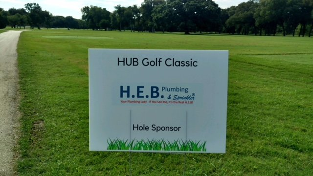 A picture of a sign stating that HEB Plumbing sponsored a hole at the HUB Young Life Golf Classic