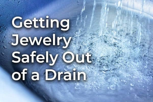 Water running into a sink drain with the words, getting jewelry out of a drain.